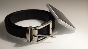 Leather belt with phone Royalty Free Stock Photo