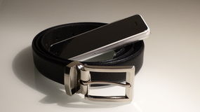 Leather belt with phone Stock Images