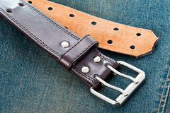 Leather belt of vintage blue jeans Stock Photo