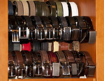 Leather belts. In various colours, wraped at the display royalty free stock image
