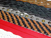 Leather belts. Few leather belts of different shapes and colors lie side by side Royalty Free Stock Photography