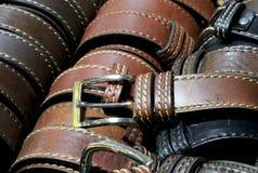 Leather belts in the Italian artisan workshop for sale. Many leather belts for sale in the Italian artisan workshop Stock Photo