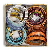 Leather belts. New multi-colored leather fashion belts are on the table isolated on white background Royalty Free Stock Photo