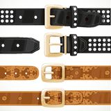 Leather belts with rivets and embroidery Stock Photo