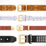Leather belts with rivets and embroidery unbuttoned Royalty Free Stock Photos