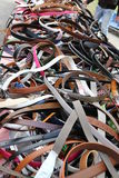 Leather belts on sale in the local market stall Royalty Free Stock Photos