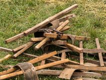Leather Belts and Sticks. Old leather belts and sticks used on old farm weat harvesters royalty free stock photos