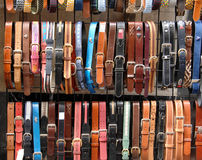 Leather belts in the store. Colorful leather belts in the store stock photo