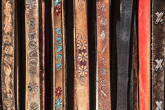 Leather belts with various designs. Leather Belts with Designs on Display Stock Photos