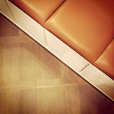 Leather bench on wooden floor Royalty Free Stock Image
