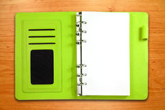 Leather binder notebook on wooden background Stock Images