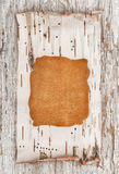 Leather and birch bark on the old wood Stock Photos
