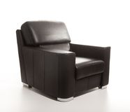 Leather black armchair isolated on white back. A studio shot of a leather black armchair isolated on white background Stock Photo