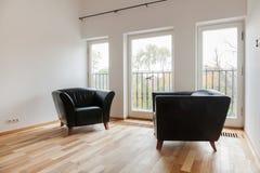 Leather black armchairs Stock Photo