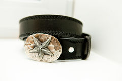 Leather black belt with a large buckle Stock Photos