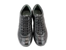 Leather black sneakers Royalty Free Stock Photography
