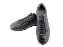 Leather black sneakers on white. Isolated. Royalty Free Stock Photography