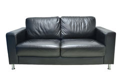 Leather black sofa isolated Stock Photography