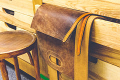 Leather blanks bag hanging on wooden beams Stock Photo
