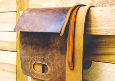Leather blanks bag hanging on wooden beams Royalty Free Stock Photography