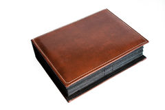 Leather book. A brown leather book with surrounding stitches Royalty Free Stock Photos