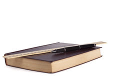 Leather book with black pen and wooden ruler. White background leather book with black pen and wooden ruler Stock Photos