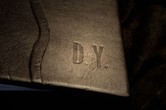 Leather book cover. Die young royalty free stock images