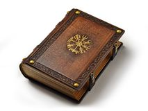 Leather book with the Vegvisir, ancient Icelandic magical symbol. The book is captured from the right side. While lay down to the table isolated royalty free stock photos