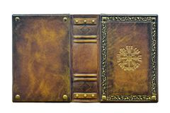 Leather book with the Vegvisir, ancient Icelandic magical symbol. The book is captured opened and frontal while stand up on the table royalty free stock images