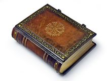 Leather book with the Vegvisir, ancient Icelandic magical symbol. The book is captured from the left side while lay down to the table stock photo