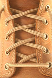 Leather boot. Close up of a brown leather boot and laces Stock Image