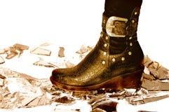 Leather boot on broken mirror stock photos