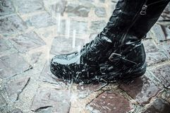leather boot in the rain on the cobblestone