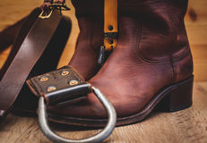 Leather boots and belt. Leather brown boots and belt Royalty Free Stock Photo
