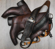 Leather boots and belt. Stylish leather boots and belt Royalty Free Stock Photos