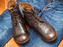 Leather boots brown and blue jeans Royalty Free Stock Photos