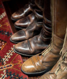 Leather Boots and Carpet Royalty Free Stock Images
