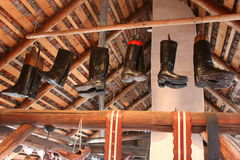 Leather boots hanging from the beam Royalty Free Stock Photography