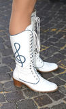 Leather boots with the treble clef of majorette of the gan Stock Photo