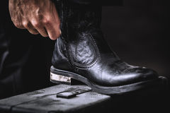 Leather boots on valise Royalty Free Stock Photo