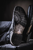 Leather boots on valise Stock Photography