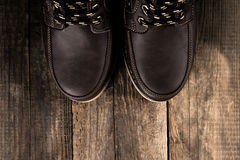 Leather boots. On wooden background Stock Photos