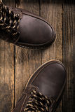Leather boots. On wooden background Royalty Free Stock Photos