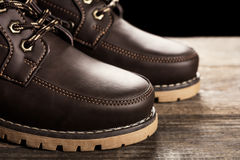 Leather boots. On wooden background Stock Image