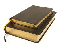 Leather bound books over white. Black leather bound books with gilded pages Stock Image