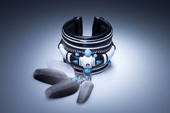 Leather bracelet with feathers and turquoise stones Stock Photography