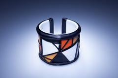 Leather bracelet with yellow white and orange mozaic elements Stock Photos