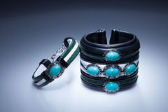 Leather bracelets with blue stones. In cool light stock image