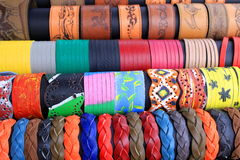 Leather bracelets. Colored handmade leather bracelets of different shapes stock photos
