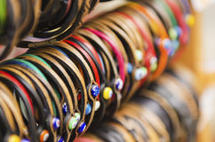 Leather Bracelets at market. Leather handmade souvenir bracelets at the street market - shopping background stock image